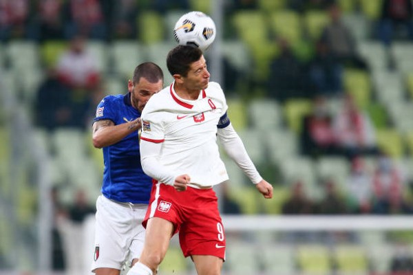 leonardo-bonucci-of-italy-tackles-robert-lewandowski-of-poland.jpg
