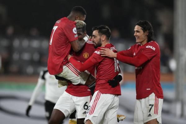 paul-pogba-of-manchester-united-celebrates-with-team-mates-fred-bruno-fernandes-and-edinson-cavani.jpg