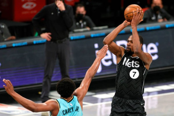 kevin-durant-of-the-brooklyn-nets-shoots-as-vernon-carey-jr-22-of-the-charlotte-hornets.jpg